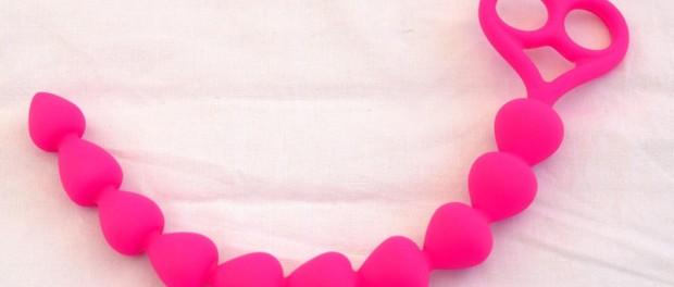 Analkette Botty von der Dildofee in rosa mit Griff und Noppen